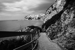 Black and white sea-village. View of a small village builded on cliff Royalty Free Stock Images
