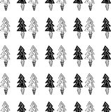 Black and white seamless Christmas pattern - varied Xmas trees and snowflakes. Winter forest illustration. Vector. Black and white seamless Christmas pattern Stock Images
