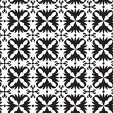 Black and white seamless geometric pattern. With decorative flowers Royalty Free Stock Image