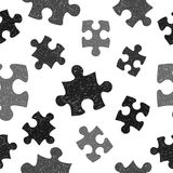 Black and white seamless pattern with doodle puzzle pieces. Vector hand drawn background Royalty Free Stock Photography