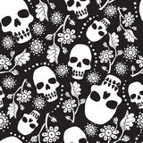 Black and white seamless pattern with flowers and skulls. Black background. Stock Photography