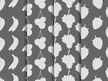 Black and white seamless pattern with fruit. Pattern of bananas, cherries, strawberries and grapes. Stock Images