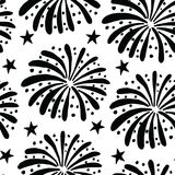 Black and white seamless pattern with hand drawn fireworks and stars. New Year celebration or party concept. Black and white seamless pattern with hand drawn Stock Images