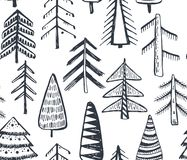 Seamless pattern with ornate Christmas trees. Royalty Free Stock Photo