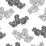 Black and white seamless pattern with holly berry. Christmas doo. Monochrome floral background with Christmas plants. Holly, doodle  illustration Stock Photo