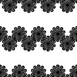 Black and white seamless pattern of lace flowers. Retro motif. Royalty Free Stock Photography