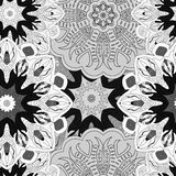 Black-and-white seamless pattern in vintage style.. Black-and-white seamless pattern made of mandalas in vintage style. Filigree ornament for background Royalty Free Stock Photography
