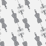 Black and white seamless pattern with vintage tailor's dummy for female body Stock Photos