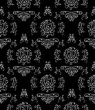 Black & white seamless wallpaper. Seamless background,white curls on the black Stock Photography