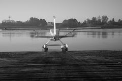 Black and white seaplane ready for flight water background stock photo