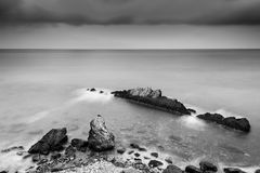 Black and white seascape. With rocks and long exposure Stock Photography