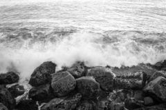 Ocean waves hits the rocks stock photos