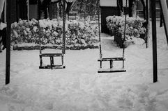 Black and white seesaw on the snow Stock Images