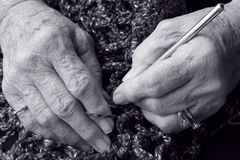 Black and white Senior hands. Senior hands in black and white royalty free stock image