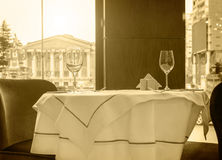 Black and white sepia tonned photo of a restaurant table Royalty Free Stock Photo