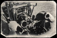 Black and White Sepia Vintage Photo of Old Rusted Car in a junkyard royalty free stock photography