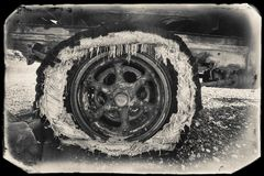 Black and White Sepia Vintage Photo of Old Rusted Car in a junkyard at the Goldfield. Ghost Town royalty free stock photography