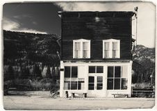Black and White Sepia Vintage Photo of Old Western Wooden Building in St. Elmo Gold Mine Ghost Town in Colorado stock photo