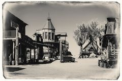 Black and White Sepia Vintage Photo of Old Western Wooden Buildings in Goldfield Gold Mine Ghost Town. In Youngsberg, Arizona, USA surrounded by cactuses royalty free stock photos