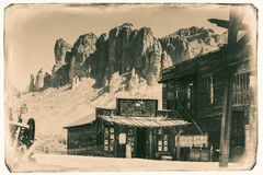 Black and White Sepia Vintage Photo of Old Western Wooden Buildings in Goldfield Gold Mine Ghost Town in Youngsberg. Arizona, USA surrounded by cactuses stock image