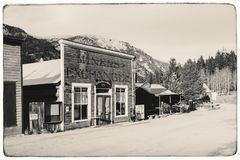 Black and White Sepia Vintage Photo of Old Western Wooden Buildings in St. Elmo Gold Mine Ghost Town stock photography