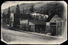 Black and White Sepia Vintage Photo of Old Western Wooden Buildings in St. Elmo Gold Mine Ghost Town in Colorado royalty free stock images