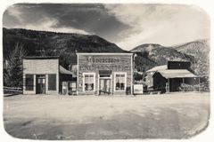 Black and White Sepia Vintage Photo of Old Western Wooden Buildings in St. Elmo Gold Mine Ghost Town in Colorado. USA hidden in mountains stock images