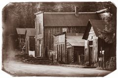 Black and White Sepia Vintage Photo of Old Western Wooden Buildings St. Elmo Gold Mine Ghost Town in Colorado royalty free stock photography