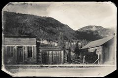 Black and White Sepia Vintage Photo of Old Western Wooden Buildings in St. Elmo Gold Mine Ghost Town in Colorado. USA hidden in mountains royalty free stock photos