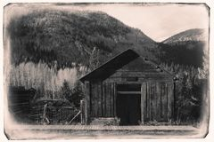 Black and White Sepia Vintage Photo of Old Western Wooden garage in St. Elmo Gold Mine Ghost Town in Colorado royalty free stock photos