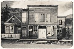 Black and White Sepia Vintage Photo of Old Western Wooden post office or saloon in St. Elmo Gold Mine Ghost Town royalty free stock photos