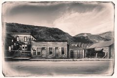 Black and White Sepia Vintage Photo of Old Western Wooden store in St. Elmo Gold Mine Ghost Town in Colorado. USA hidden in mountains stock images