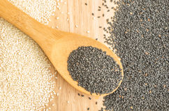 Black and White Sesame Seeds on Wooden Background Stock Photography