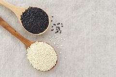 Sesame seeds background. Black and white sesame in wood bowl background with space royalty free stock photos