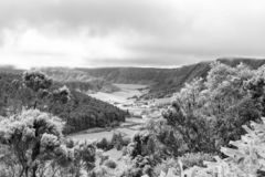 Black and White Sete Sidades Crater. Black and white view of part of the massive Sete Sidades Caldera with the smaller Alferes Caldera in the bottom left royalty free stock photo