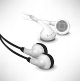 Black and white sets of headphones Royalty Free Stock Photos
