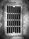 Black and white sewer drain Royalty Free Stock Photos