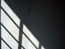 Black and white shadows. On a textured wall Royalty Free Stock Image