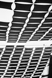 Black and white shadows. Top of a cloth roof with its shadows on the wall royalty free stock images