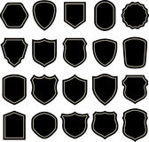 Black and white shield silhouette. Set Stock Images