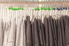 Black and white shirt on hangers Stock Photo