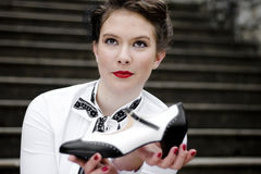 Black and white shoe. Young attractive women dressed in forties style, swing era Royalty Free Stock Image
