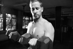 Black And White Shot Of Bare Chested Man Lifting Weights Stock Photography