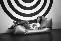 Black and white shot of beautiful woman in studio on mattress Stock Images