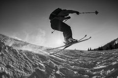Black and white shot of free skier jumping. Off a kicker Stock Photos