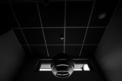 Black and white shot of futuristic lamp in corridor ceiling of modern business office building Royalty Free Stock Photo