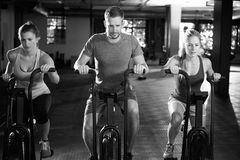 Black And White Shot Of Gym Class Using Cross Trainers Royalty Free Stock Photography