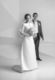 Black and white shot of happy bride with bouquet at studio Royalty Free Stock Images