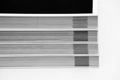 Black and white shot of a lot of books on each other Royalty Free Stock Photos