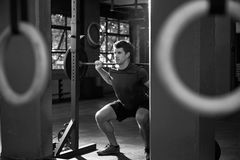 Black And White Shot Of Man Clean And Jerk Lifting Weights Stock Image